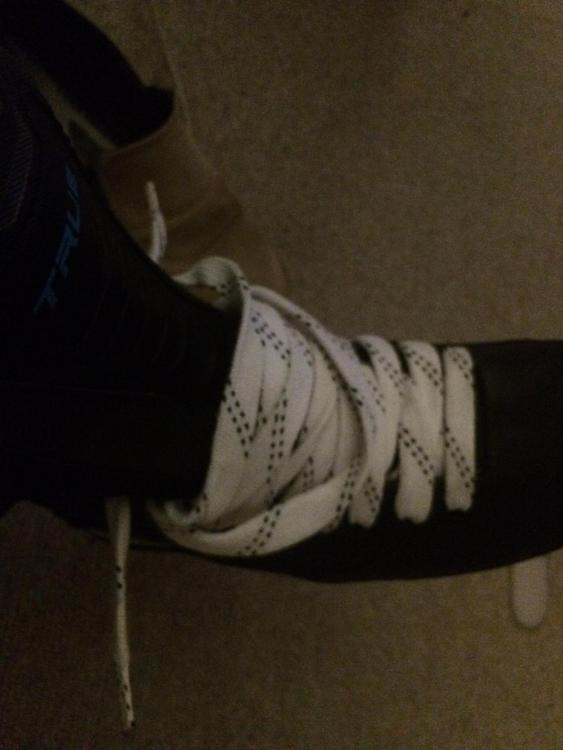 Skates put on and off with laces all the way up.JPG
